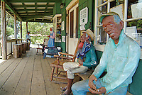 Lifelike, carved wooden statues greet customers on the porch of the Ulupalakua Ranch General Store in Upcountry, Maui.