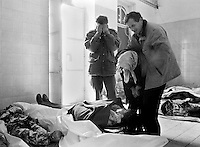 Family members grieve as they identify one of their own in the morgue at Sarajevo's Kosevo hospital on January 7, 1993.