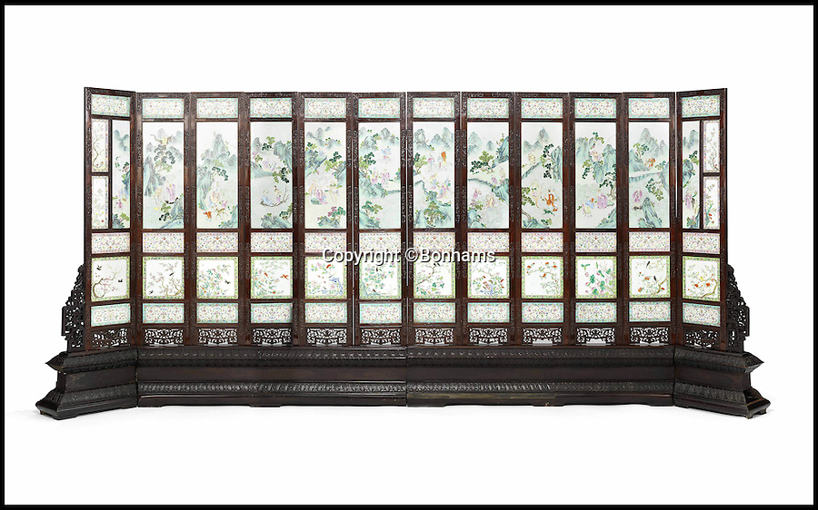BNPS.co.uk (01202 558833)<br /> Pic: Bonhams/BNPS<br /> <br /> ****Must use full byline****<br /> <br /> Chinese screen.<br /> <br /> A rare 200-year-old decorative screen that was originally owned by a Chinese emperor has come to light and is set to fetch £1.2 million at auction.<br /> <br /> The stunning Imperial object was owned by the Jiaqing Emperor, who reigned from 1796 to 1820 and features 64 porcelain panels which are decorated with scenes of Daoist Immortals - images that represent good fortune and longevity.<br /> <br /> The beautiful plaques show images of flowers, birds, and symbols and are framed by 12 leaves made from huanghuali wood.<br /> <br /> Screens were often used for decorative purposes and stood behind the thrones to show luxury and power.<br /> <br /> It has been owned by an Italian family for the last 40 years who are now selling it through Bonhams auctions in London.