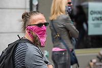 """Auf und rund um den Rosa-Luxemburg-Platz in Berlin-Mitte haben am Samstag den 25. April 2020 mehrere hundert Menschen gegen die Einschraenkungen im Zuge der Massnahmen zur Eindaeemung der Covid-19-Pandemie protestiert. Rechtsextremisten, Hooligans, Antisemiten, Verschwoerungstheoretiker und AfD-Politiker hatten zu einer sogenannten """"Hygiene-Demo"""" versammelt. Vereinzelt protestierten Menschen am Rande gegen diese Demonstration.<br /> Die Polizei war mit mehreren hundert Beamten im Einsatz und nahm mehr als 100 Personen fest.<br /> Im Bild: Ein Demonstrant traegt zur Veralberung der Empfehlung Mund-Nase-Schutzmasken zu tragen einen rosa Damenslip im Gesicht.<br /> 25.4.2020, Berlin<br /> Copyright: Christian-Ditsch.de<br /> [NUR FUER REDAKTIONELLE ZWECKE! Werbung nur auf Anfrage beim Fotografen. Inhaltsveraendernde Manipulation des Fotos nur nach ausdruecklicher Genehmigung des Fotografen. Vereinbarungen ueber Abtretung von Persoenlichkeitsrechten/Model Release der abgebildeten Person/Personen liegen nicht vor. NO MODEL RELEASE! Don't publish without copyright Christian-Ditsch.de, Veroeffentlichung nur mit Fotografennennung, sowie gegen Honorar, MwSt. und Beleg. Konto: I N G - D i B a, IBAN DE58500105175400192269, BIC INGDDEFFXXX, Kontakt: post@christian-ditsch.de<br /> Bei der Bearbeitung der Dateiinformationen darf die Urheberkennzeichnung in den EXIF- und  IPTC-Daten nicht entfernt werden, diese sind in digitalen Medien nach §95c UrhG rechtlich geschuetzt. Der Urhebervermerk wird gemaess §13 UrhG verlangt.]"""