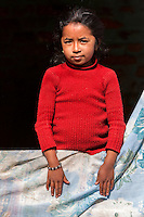 Nepal, Patan.  Young Nepalese Girl Looking out from her Window.
