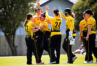 The Blaze team celebrates Rebecca Burns' catch of Anlo van Deventer during the women's Hallyburton Johnstone Shield one-day cricket match between the Wellington Blaze and Central Hinds at Donnelly Park in Levin, New Zealand on Sunday, 6 December 2020. Photo: Dave Lintott / lintottphoto.co.nz