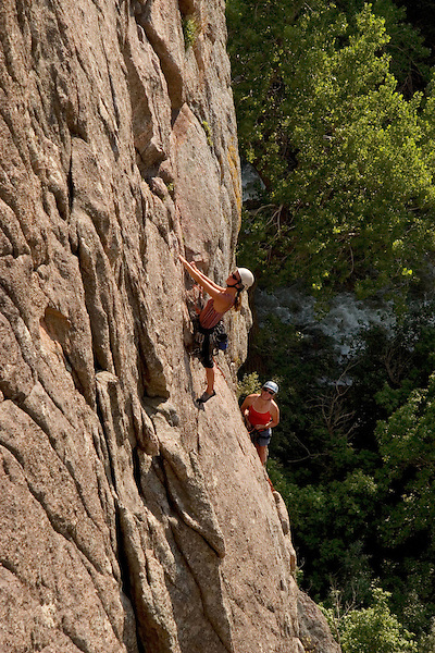 Caucasian women rock climbers on the Elephant Buttress rock formation in Boulder Canyon, Rocky Mountains, Boulder, Colorado, USA .  John leads private photo tours in Boulder and throughout Colorado. Year-round.