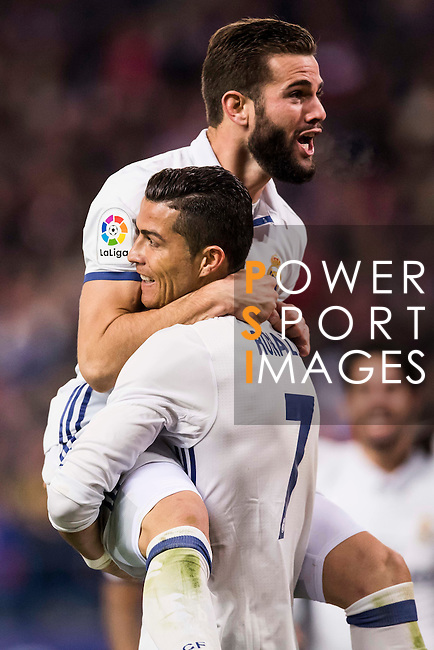 Cristiano Ronaldo of Real Madrid celebrates with teammate Nacho after scoring Real's 3rd goal  during their La Liga match between Atletico de Madrid and Real Madrid at the Vicente Calderón Stadium on 19 November 2016 in Madrid, Spain. Photo by Diego Gonzalez Souto / Power Sport Images