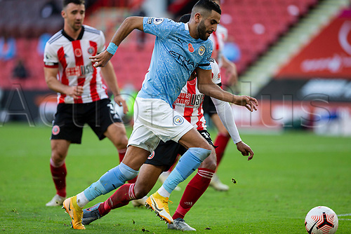 31st October 2020; Bramall Lane, Sheffield, Yorkshire, England; English Premier League Football, Sheffield United versus Manchester City; Riyad Mahrez of Manchester City  breaks forward with the ball past Oliver Burke of Sheffield United