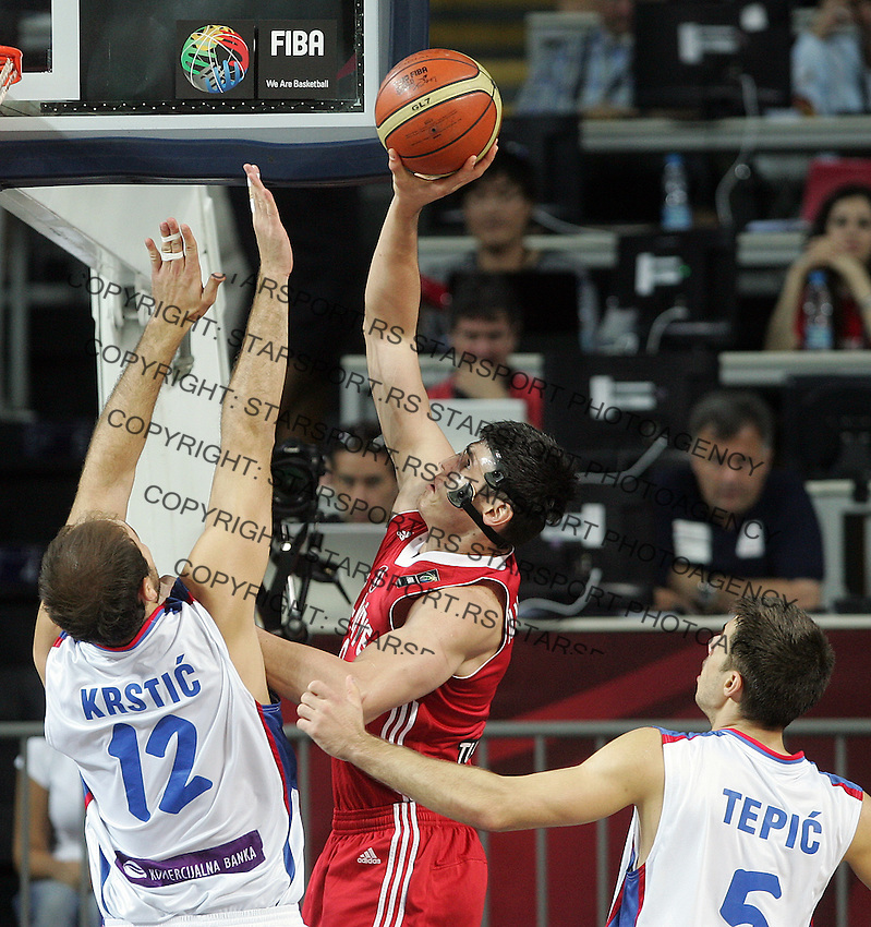Ersan ILYASOVA (Turkey)  passes Nenad KRSTIC (Serbia)  and Milenko TEPIC (Serbia) during the semi-final World championship basketball match against Serbia in Istanbul, Serbia-Turkey, Turkey on Saturday, Sep. 11, 2010. (Novak Djurovic/Starsportphoto.com) .