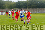 St Marys Jack Daly makes ground but challenges from Waterville's Adam O'Dwyer & Alan Dwyer bring this run to an end.