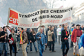 Railway workers march in Paris, joining up to 3 million people across France during a national strike against the Sarkozy government's economic policies.