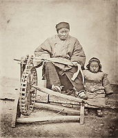 BNPS.co.uk (01202 558833)<br /> Pic: ForumAuctions/BNPS<br /> <br /> Pictured: A woman pictured with a young child <br /> <br /> Rarely seen 150 year old photos taken by one of the first British photographers to explore China have emerged for sale for £20,000.<br /> <br /> Scotsman John Thomson (1837-1921) travelled to the Far East in 1868 and established a studio in Hong Kong, using it as a base to explore remote parts of the vast country for the next four years, photographing landmarks, scenery and the native population.<br /> <br /> In many cases, he was the first Westerner the people he photographed had encountered.<br /> <br /> One striking image shows a prisoner in chains with a head poking through a board covered in Chinese symbols, perhaps listing his misdemeanours. In another, a man poses next to a giant camel statue in the grounds around the Ming tombs of the Forbidden City.<br /> <br /> Almost 100 of his photos feature in a rare first edition of 'Thomson Illustrations of China and Its People' (1873), which is going under the hammer with London-based Forum Auctions.