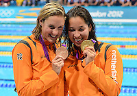August 04, 2012..Marleen Veldhuis, Ranomi Kromowidjojo, pose with 50m Freestyle Bronze, and Gold Medal at the Aquatics Center on day eight of 2012 Olympic Games in London, United Kingdom..