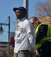 STAFF PHOTO BEN GOFF  @NWABenGoff -- 11/25/14 A Fayetteville police officer arrests Jared Carter after demonstrators blocked traffic during a protest organized by the OMNI Center for Peace, Justice & Ecology in front of the Washington County Courthouse in Fayetteville on Tuesday Nov. 25, 2014. Four demonstrators volunteered to make a statement by being arrested. The demonstration was in response to the decision Monday night by the St. Louis County grand jury not to indict police officer Darren Wilson, who fatally shot Michael Brown in Ferguson, Mo.