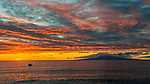 Sunset looking west from the shore of Kihei, Maui. The island in the distance is Lanai.