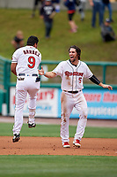 Rochester Red Wings Luis Arraez (9) celebrates a walk off single with Drew Maggi (5) during an International League game against the Charlotte Knights on June 16, 2019 at Frontier Field in Rochester, New York.  Rochester defeated Charlotte 3-2 in the second game of a doubleheader.  (Mike Janes/Four Seam Images)