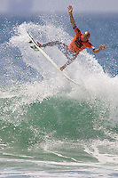 9 time world champion American Kelly Slater with an air during round of 96 at the 2010 US Open of Surfing in Huntington Beach, California on August 4, 2010.
