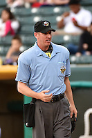 Home plate umpire Scott Mahoney during the game between the Fresno Grizzlies and Salt Lake Bees in Pacific Coast League action at Smith's Ballpark on April 9, 2014 in Salt Lake City, Utah.  (Stephen Smith/Four Seam Images)
