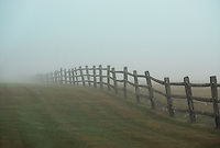 Wooden farm fence on a foggy morning, Connecticut, USA