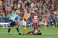 Houston Dynamo defender Eddie Robinson (2) stands over a fallen FC Dallas midfielder Marcelo Saragosa (5) following an altercation. Both players received yellow cards for the play. Houston Dynamo vs FC Dallas at Pizza Hut Park in Frisco, Texas May-28-2008. Final Score 2-2