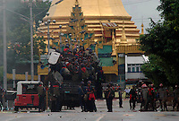 The army and riot police block roads next to a pagoda in response to continued protests led by Buddhist monks calling for the overthrow of the country's military junta. A number of protesters were killed after the military threatened that they would shoot on sight any gatherings of over four people.