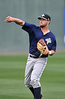 Third baseman David Thompson (8) of the Columbia Fireflies warms up before a game against the Greenville Drive on Thursday, April 21, 2016, at Fluor Field at the West End in Greenville, South Carolina. Columbia won, 13-9. (Tom Priddy/Four Seam Images)