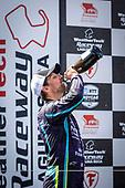 #51: Romain Grosjean, Dale Coyne Racing with RWR Honda, podium, champagne