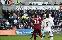 Pictured: Swansea's Ki Sung Yeung with a header against Newcastle United. <br />