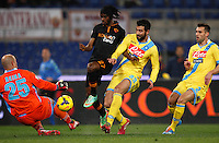Calcio, semifinale di andata di Coppa Italia: Roma vs Napoli. Roma, stadio Olimpico, 5 febbraio 2014.<br /> AS Roma forward Gervinho, of Ivory Coast, second from left, runs on his way to score as Napoli goalkeeper Jose' Manuel Reina, of Spain, left, and defenders Raul Albiol, of Spain, second from right, and Anthony Reveillere, of France, try to stop him during the Italian Cup first leg semifinal football match between AS Roma and Napoli at Rome's Olympic stadium, 5 February 2014.<br /> UPDATE IMAGES PRESS/Riccardo De Luca