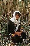 Marsh Arabs. Southern Iraq. Marsh Arab young man with hunting rifle amongst reed banks. Haur al Mamar or Haur al-Hamar marsh collectively known now as Hammar marshes Iraq 1984