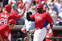 Philadelphia Phillies Ryan Howard #6 is greeted at home by Raul Ibanez #29 after hitting a home run during a spring training game against the Baltimore Orioles at Bright House Field in Clearwater, Florida;  March 8, 2011.  Photo By Mike Janes/Four Seam Images