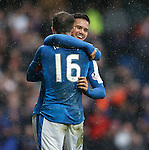 Harry Forrester and Andy Halliday bac on their feet and hugging each other
