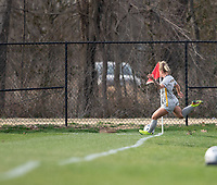 LOUISVILLE, KY - MARCH 13: Juliana Lynch #4 of West Virginia University takes a corner kick during a game between West Virginia University and Racing Louisville FC at Thurman Hutchins Park on March 13, 2021 in Louisville, Kentucky.