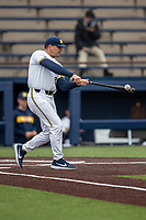 Michigan Wolverines head coach Erik Bakich (23) hits infield practice before the NCAA baseball game against the Michigan State Spartans on May 7, 2019 at Ray Fisher Stadium in Ann Arbor, Michigan. Michigan defeated Michigan State 7-0. (Andrew Woolley/Four Seam Images)