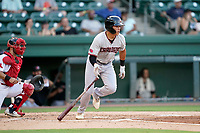 First baseman Dustin Harris (9) of the Hickory Crawdads in a game against the Greenville Drive on Tuesday, August 24, 2021, at Fluor Field at the West End in Greenville, South Carolina. The catcher is Elih Marrero (10). (Tom Priddy/Four Seam Images)