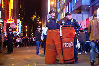 Police officers ready their infamous orange nets in Times Square on October 15, 2011 in New York City.  While crowd estimates numbered in the tens of thousands, police tactics (including nets, motor scooters, barricades, arrests, and intimidation by riders on horseback) prevented the crowd, which had been split up, from joining together as one in the middle of Times Square.