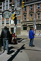 Toronto (ON) CANADA, April 19, 2007<br /> <br /> A pedestrian wait outside a Starbuck coffe shop, to cross  King Street East<br /> <br /> Photo by Pierre Roussel - Images Distribution