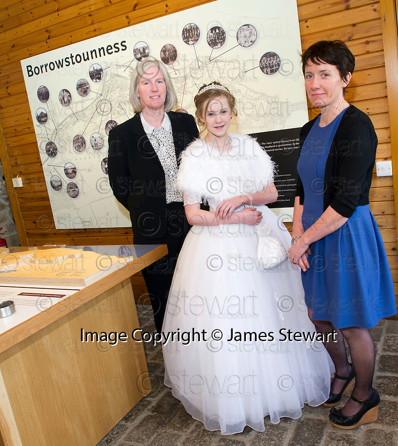 Falkirk Community Trust Chief Executive Maureen Campbell (left) is joined by Bo'ness Fair Queen Louise Wilson and Curator Niamh Conlon to officially open the new exhibition at Kinneil Museum.