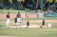 STANFORD, CA - MAY 29: Helpers after a game between Oregon State University and Stanford Baseball at Sunken Diamond on May 29, 2021 in Stanford, California.