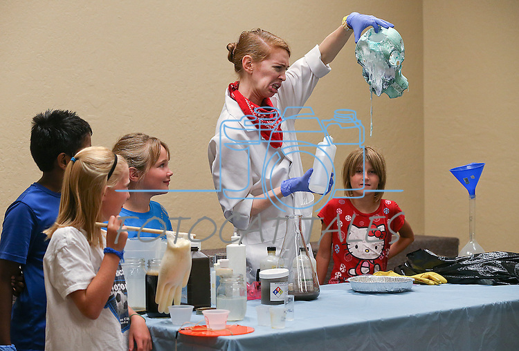 Radioactive Rachel performs an experiment during the Mad Science program at the Carson City Library, in Carson City, Nev., on Tuesday, July 15, 2014.<br /> Photo by Cathleen Allison