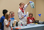 Radioactive Rachel performs an experiment during the Mad Science program at the Carson City Library, in Carson City, Nev., on Tuesday, July 15, 2014.<br />