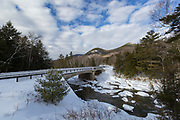 Bridge along the Kancamagus Scenic Byway (Route 112) in Lincoln, New Hampshire during the winter months. This bridge crosses the East Branch of the Pemigewasset River. The Hancock Branch of the East Branch & Lincoln Railroad began at this location.
