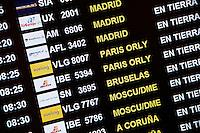 Flight status display in airport terminal, Barcelona, Spain