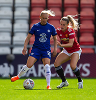 6th September 2020; Leigh Sports Village, Lancashire, England; Women's English Super League, Manchester United Women versus Chelsea Women; Joanna Andersson of Chelsea Women is tackled by Abbie McManus of Manchester United Women