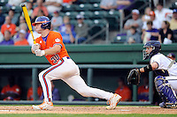 Catcher Garrett Boulware (30) of the Clemson Tigers bats in a game against the Furman Paladins on Wednesday, May 8, 2013, at Fluor Field at the West End in Greenville, South Carolina. (Tom Priddy/Four Seam Images)