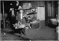 At center market. 11 year old celery vender. He sold until 11 P.M. and was out again Sunday morning selling papers,  13 April 1912