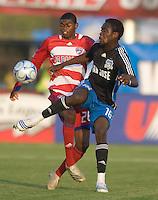 Kei Kamara, right,  volleys the ball in front of Anthony Wallace, left. The San Jose Earthquakes tied FC Dallas 0-0, at Buck Shaw Stadium, in Santa Clara, California, Saturday, May 3, 2008. .