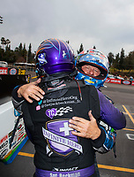 Feb 9, 2020; Pomona, CA, USA; NHRA funny car driver John Force (right) congratulates Jack Beckman after winning the Winternationals at Auto Club Raceway at Pomona. Mandatory Credit: Mark J. Rebilas-USA TODAY Sports