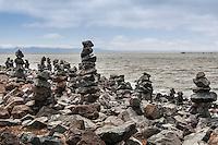 Rock Balancing - an art form or hobby.  Rocky creations rise along the rocky shores of the San Leandro Marina on San Francisco Bay