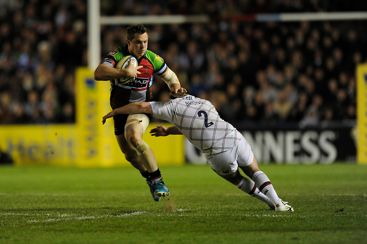 Tim Molenaar of Harlequins is tackled by Neil Briggs of Leicester Tigers during the Aviva Premiership match between Harlequins and Leicester Tigers at the Twickenham Stoop on Friday 18th April 2014 (Photo by Rob Munro)
