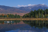 Canoeists on Kidney Pond looking at the west side of Mount Katahdin, in Baxter State Park, Maine
