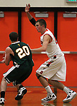 Douglas' James Herrick defends Manogue's Steve Werth during a boys basketball game between Bishop Manogue and Douglas High in Minden, Nev., on Thursday, Dec. 22, 2011..Photo by Cathleen Allison