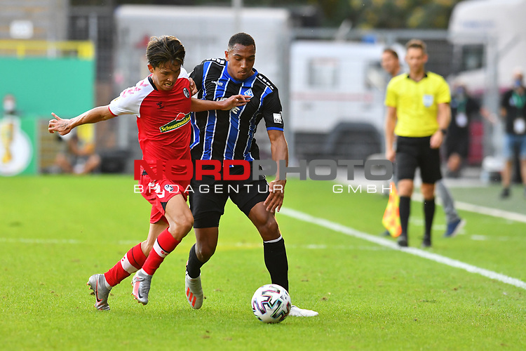 13.09.2020, Carl-Benz-Stadion, Mannheim, GER, DFB-Pokal, 1. Runde, SV Waldhof Mannheim vs. SC Freiburg, <br /> <br /> DFL REGULATIONS PROHIBIT ANY USE OF PHOTOGRAPHS AS IMAGE SEQUENCES AND/OR QUASI-VIDEO.<br /> <br /> im Bild: Woo-yeong Jeong (SC Freiburg #29) gegen Anton Donkor (SV Waldhof Mannheim #19)<br /> <br /> Foto © nordphoto / Fabisch